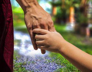 parent holding hands