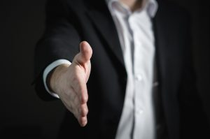 Man in suit extending hand in greeting