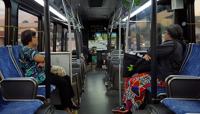 Two women not speaking on a bus