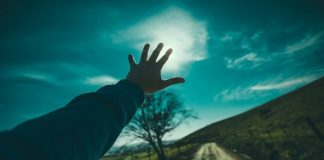 hand stretched towards the light