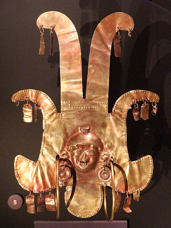 Tumbaga gold colored ancient ornament.