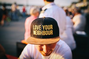 Man wearing cap that says love your neighbor charity