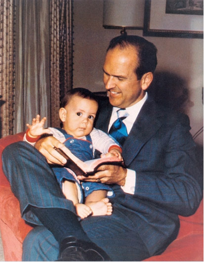 President Russell M. Nelson with his baby son, Russell M. Nelson Jr. on his lap