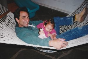 Father and baby on hammock