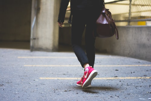 Person walking away from the camera with Nike shoes on