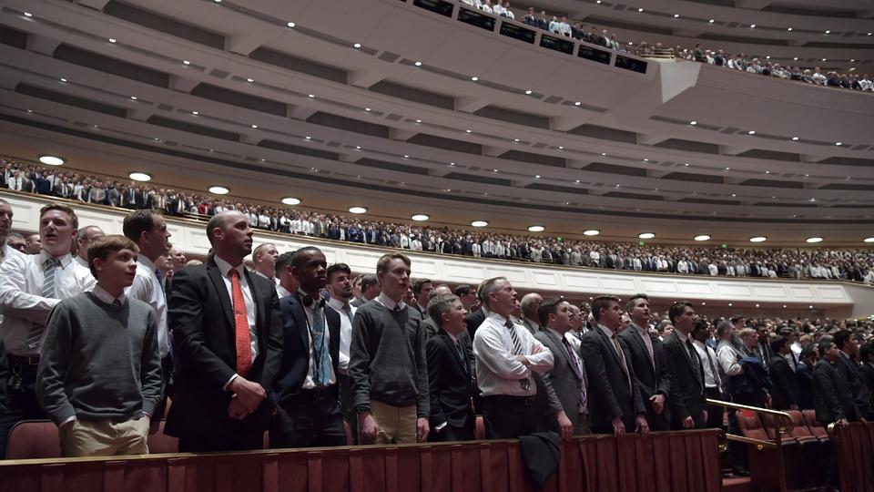 men stand at LDS general conference