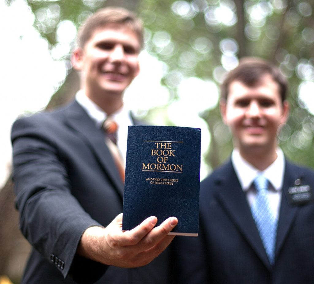Missionaries teach with the Book of Mormon