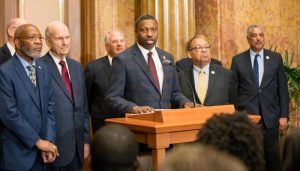 Derrick Johnson making statement with LDS church leaders