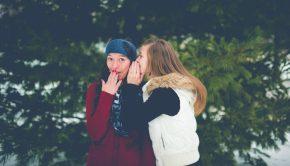 Two young women gossiping