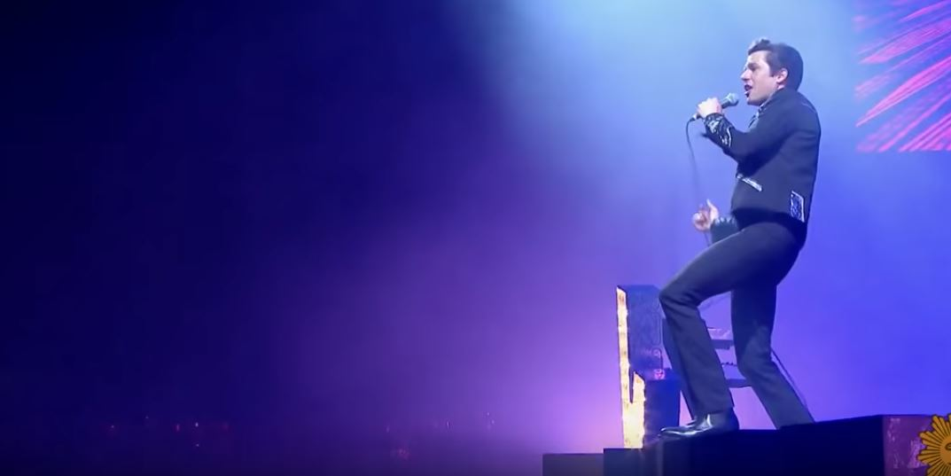 Brandon Flowers in concert with his band, The Killers