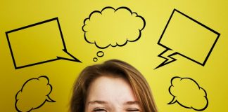 Woman with thought bubbles above her head on yellow background