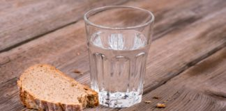 Glass of water and broken bread