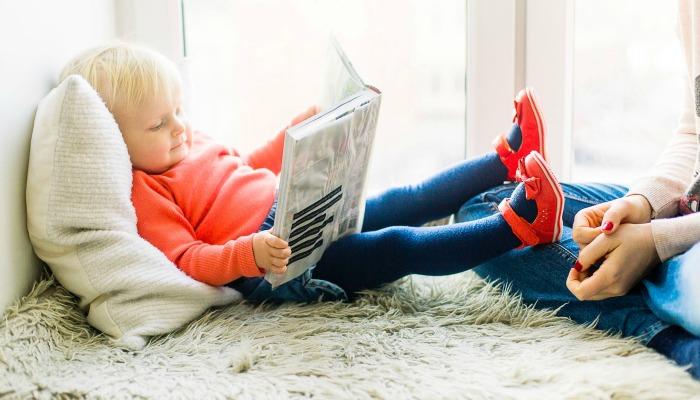 Child reading children's book.