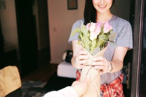 giving bouquet of flowers