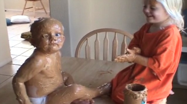 Kids playing in peanut butter.