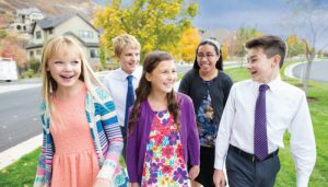 lds youth walking down the street in a group.