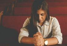 Girl sitting in church pews without sacrament