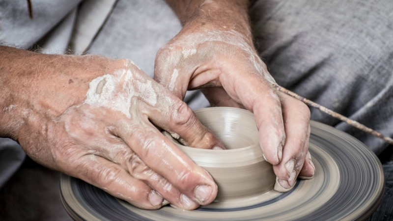 hands sculpting pottery bowl