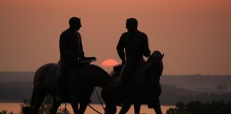 Joseph and Hyrum Smith on horseback sunset
