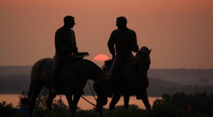 Joseph and Hyrum Smith on horseback sunset