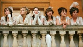 Bennet sisters on a balcony