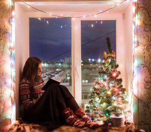 girl reading book Christmas