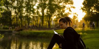 girl reading by pond mormon