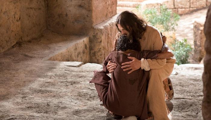 Jesus embraces blind man