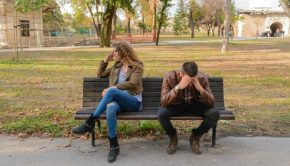 couple on park bench arguing