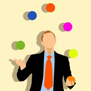 A clipart of a man juggling multicolored balls.