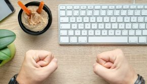 fists on desk with keyboard