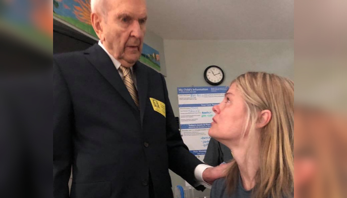 Photo of President Nelson visiting a woman in the hospital.