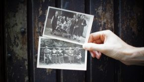 Hand holding two vintage photographs