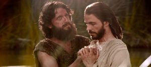 John the Baptist baptizing Jesus.