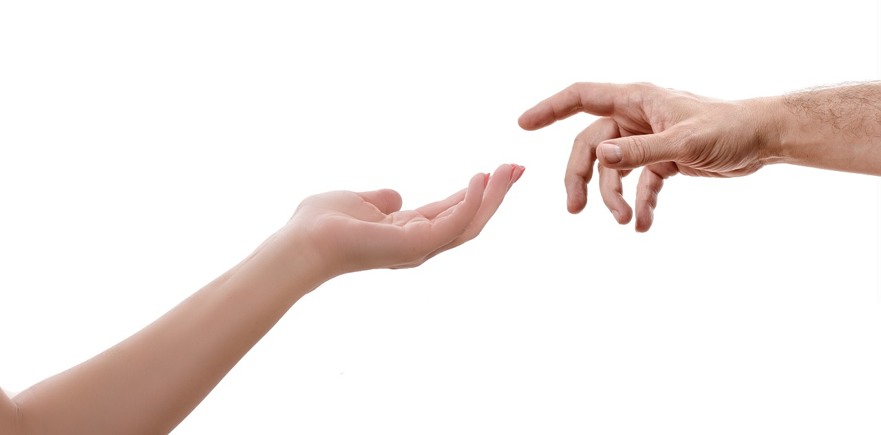 hand touching God
