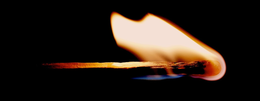 A lit match.