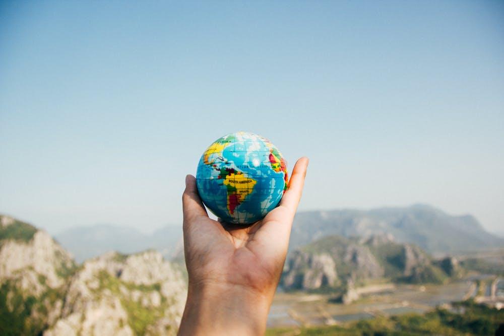 globe hand small nation world