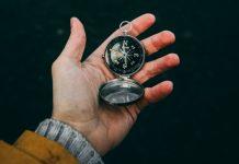 Man holding compass.