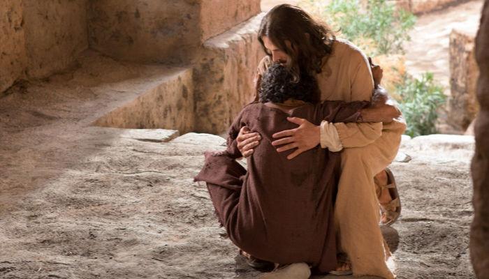 Photo of Jesus Christ hugging a man.