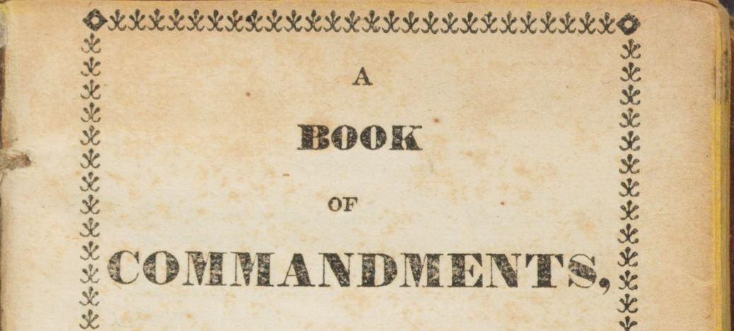 "Title page of ""A Book of Commandments,"" saved in part by Mary Rollins."