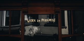 door with writing that says work in progress