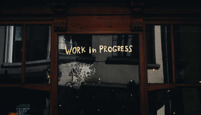 door with writing that says work in progress