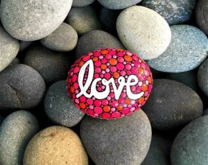 valentine's day painted rock with the word love
