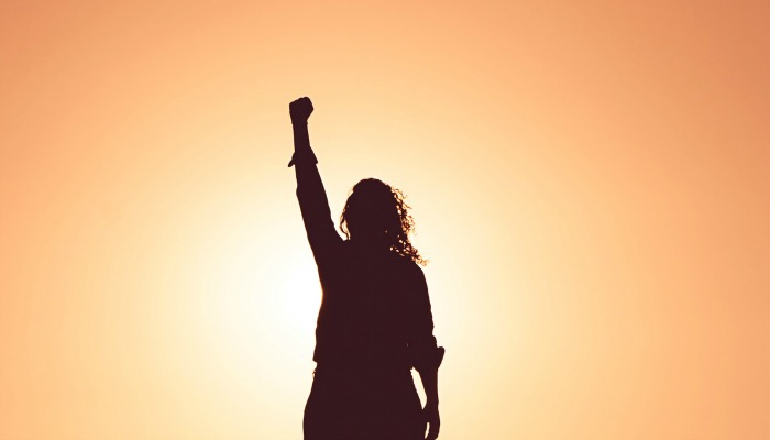 woman standing with fist in air