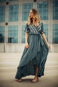Woman standing in wrap dress