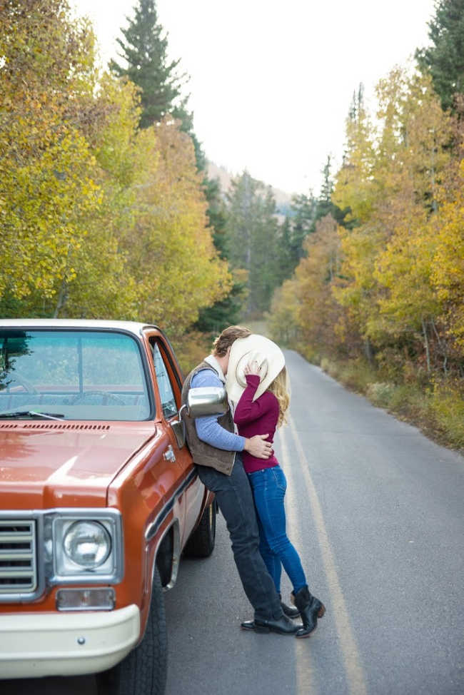 couple kissing next to a truck