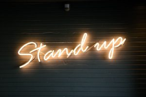 Neon Sign that says Stand Up