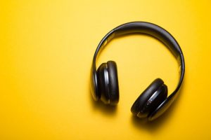 wireless headphones on a yellow background