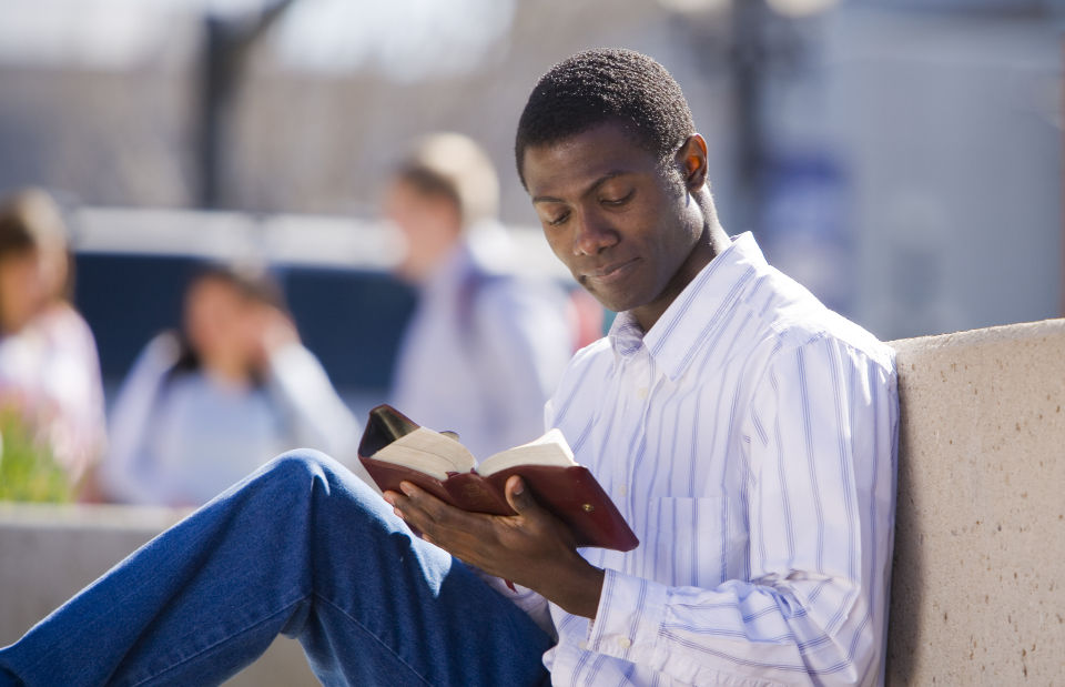 man reading scriptures before working in the temple