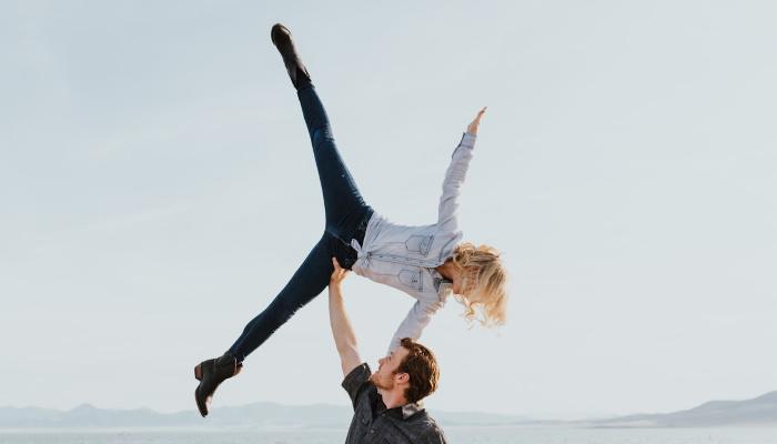 man lifting woman into the air